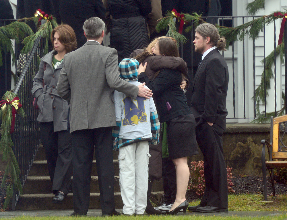 . Mourners December 17, 2012 at the funeral for Jack Pinto, 6, one of the victims of the December 14, Sandy Hook elementary school shooting, in Newtown, Connecticut.  Funerals began Monday in the little Connecticut town of Newtown after the school massacre that took the lives of 20 small children and six staff, triggering new momentum for a change to America\'s gun culture.  AFP PHOTO/Emmanuel  DUNAND/AFP/Getty Images