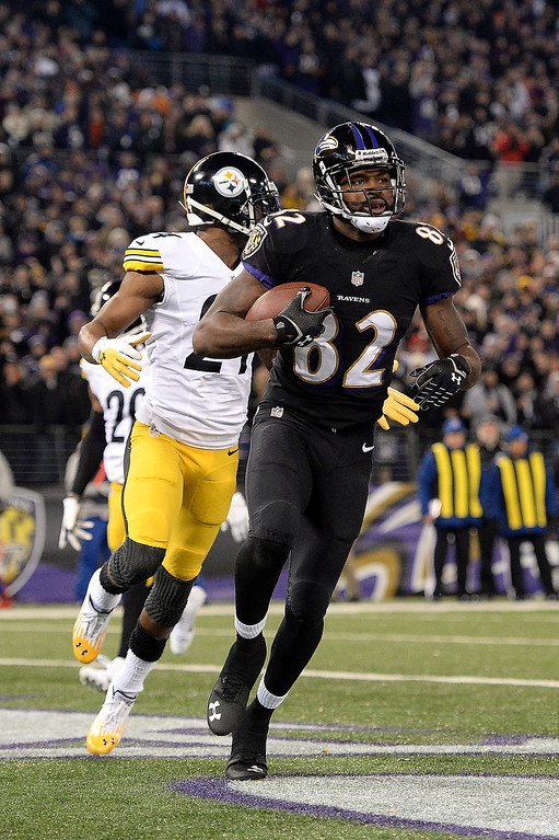 Description of . Torrey Smith #82 of the Baltimore Ravens scores a touchdown in the first quarter of an NFL game against the Pittsburgh Steelers at M&T Bank Stadium on November 28, 2013 in Baltimore, Maryland.  (Photo by Patrick Smith/Getty Images)