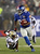 David Wilson #22 of the New York Giants carries the ball past Isa Abdul-Quddus #42 of the New Orleans Saints to score his third touchdown of the game on December 9, 2012 at MetLife Stadium in East Rutherford, New Jersey.  (Photo by Elsa/Getty Images)