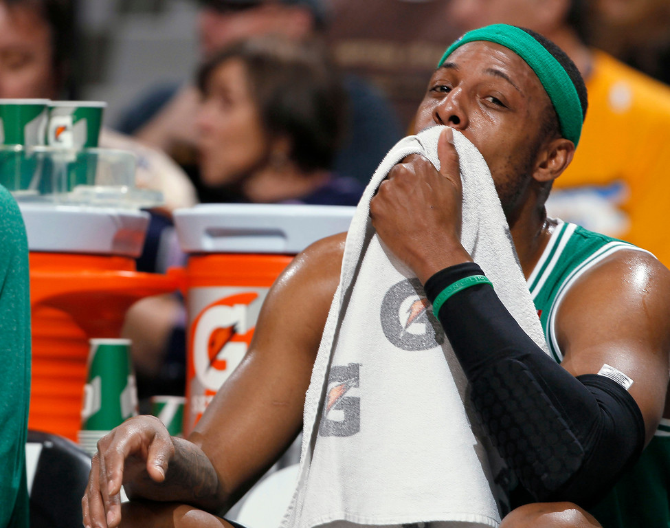 Description of . Boston Celtics forward Paul Pierce takes a seat on the bench during the first quarter of an NBA basketball game against the Denver Nuggets in Denver on Tuesday, Feb. 19, 2013. (AP Photo/David Zalubowski)