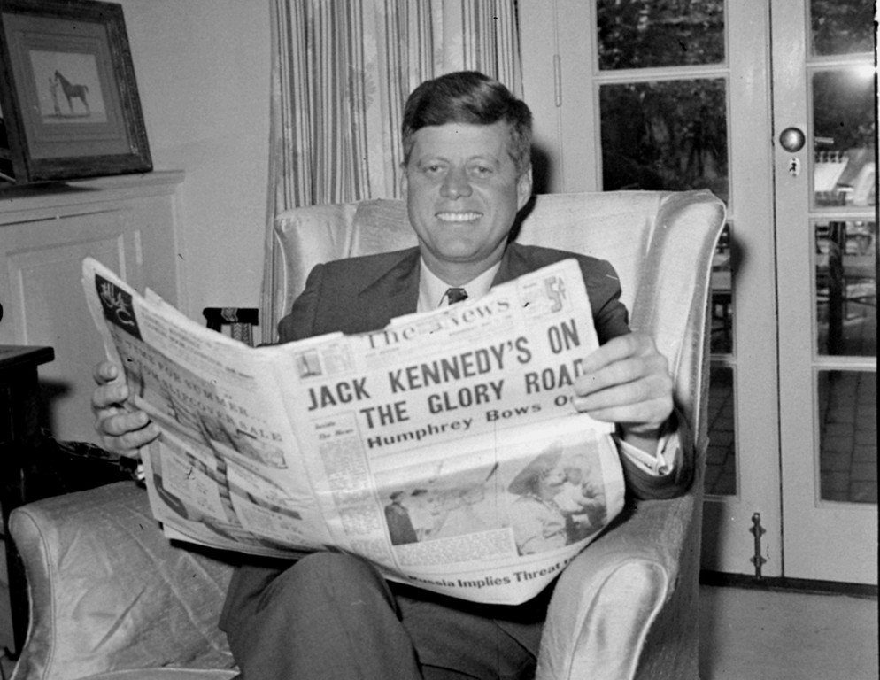 Description of . Sen.Kennedy reads accounts of his West Virginia election victory May 11, 1960, in his Washington home.  Kennedy defeated Sen. Hubert Humphrey in the presidential primary.  Henry Burroughs, Associated Press file