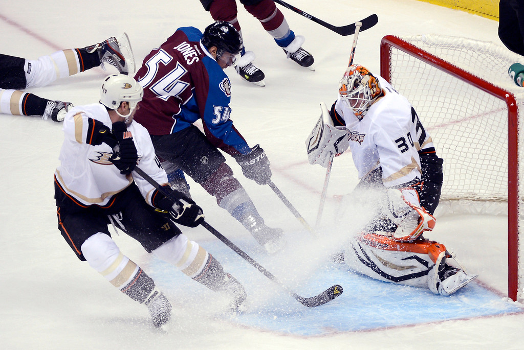 Description of . DENVER, CO. - FEBRUARY 06: Viktor Fasth (30) of the Anaheim Ducks makes a save on a shot by David Jones (54) of the Colorado Avalanche as Sheldon Souray (44) of the Anaheim Ducks defends on the play during the second period February 6, 2013 at Pepsi Center. The Colorado Avalanche take on the Anaheim Ducks during NHL action. (Photo By John Leyba / The Denver Post)