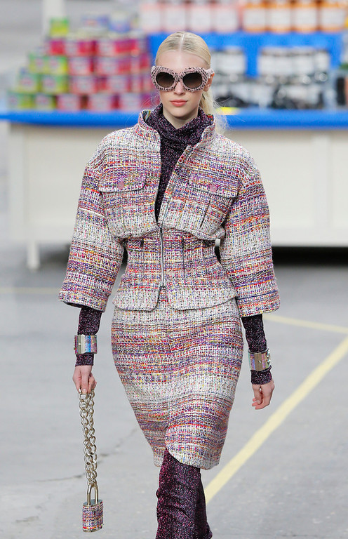 Description of . A model wears a creation for Chanel's ready to wear fall/winter 2014-2015 fashion collection presented in Paris, Tuesday, March 4, 2014. (AP Photo/Jacques Brinon)