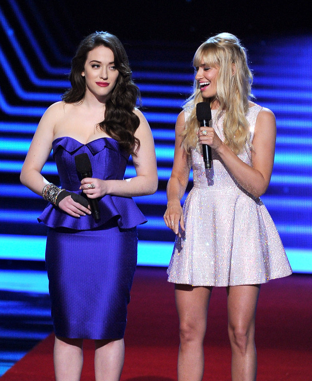 Description of . LOS ANGELES, CA - JANUARY 08:  Co-hosts Kat Dennings (L) and Beth Behrs speak onstage at The 40th Annual People's Choice Awards at Nokia Theatre L.A. Live on January 8, 2014 in Los Angeles, California.  (Photo by Kevin Winter/Getty Images)