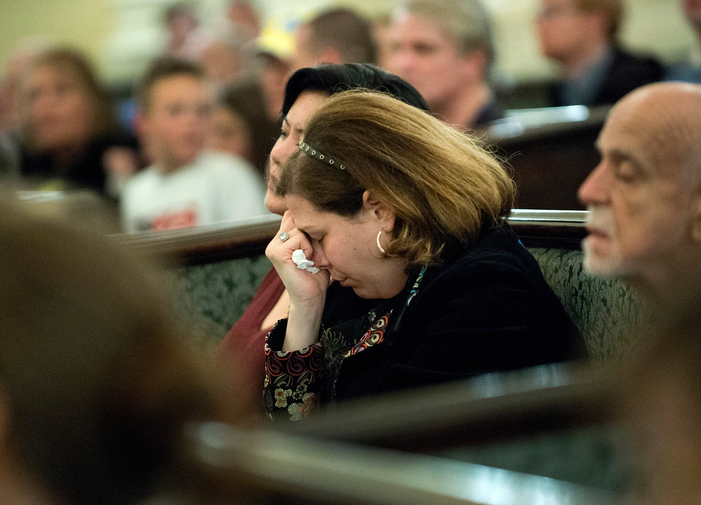 Description of . Mourners in the Arlington Street Church gather for a candle light vigil April 16, 2013 in Boston. Several hundred people gathered to remember the victims of the bomb which exploded during the running of the Boston Marathon.  DON EMMERT/AFP/Getty Images