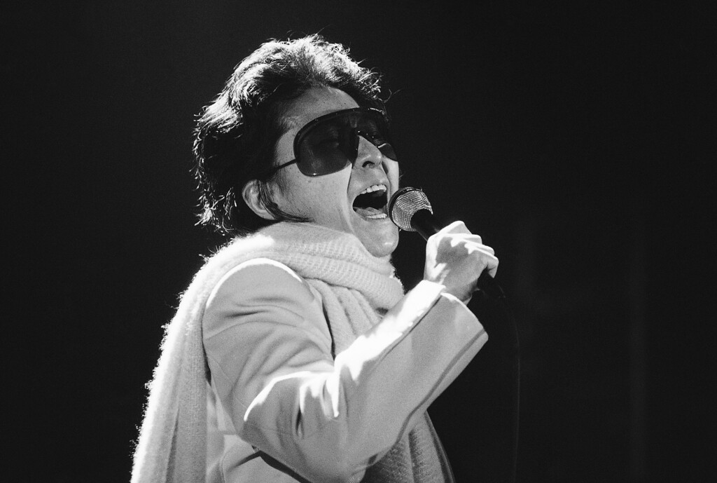 Description of . Yoko Ono, widow of former Beatles John Lennon, performs in Warsaw, Poland  in evening on Tuesday, March 5, 1986 as part of her European tour. (AP Photo)