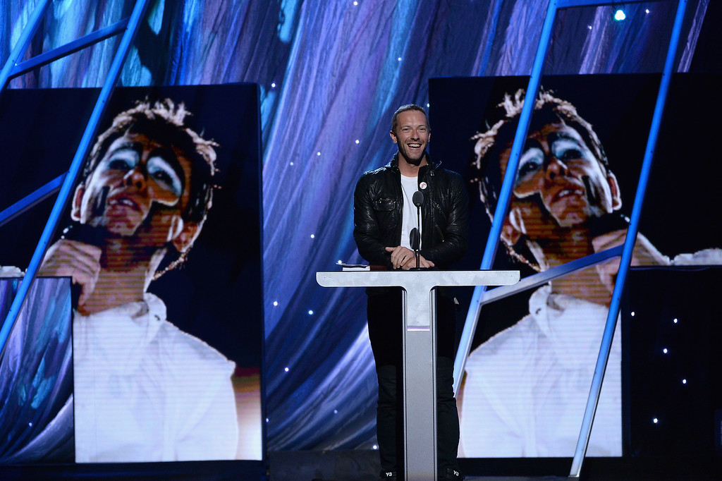 Description of . Musician Chris Martin speaks onstage at the 29th Annual Rock And Roll Hall Of Fame Induction Ceremony at Barclays Center of Brooklyn on April 10, 2014 in New York City.  (Photo by Larry Busacca/Getty Images)