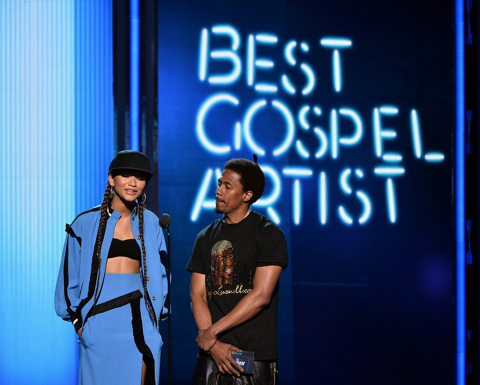 Description of . Actress Zendaya and TV personality Nick Cannon speak onstage during the BET AWARDS '14 at Nokia Theatre L.A. LIVE on June 29, 2014 in Los Angeles, California.  (Photo by Kevin Winter/Getty Images for BET)