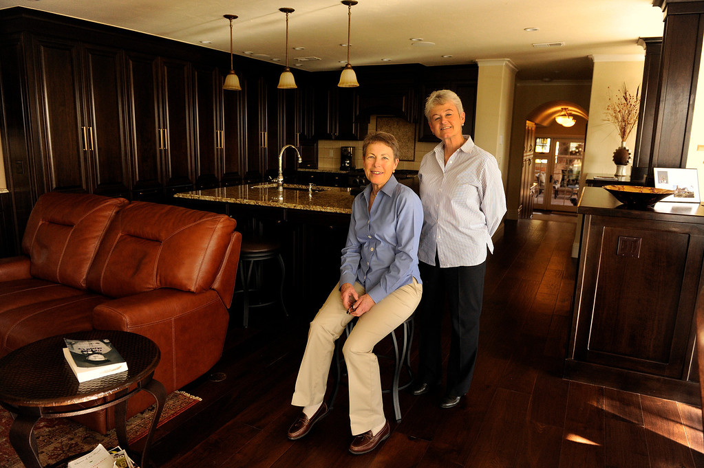 Description of . DENVER, CO - NOVEMBER 13: Jeannine Spicer, left, and June Eshelman, right, pose for a portrait inside their renovated home on November 13, 2013, in Denver, Colorado. Spicer's parents purchased the house in 1964 and continued to live there until her mother's passing in 2010. During that time, the house underwent few renovations. When Spicer inherited the property, she decided to fully demolish the interior, while still preserving the historic and architectural characteristics of the 1936 Tudor building. For their efforts, Spicer and Eshelman won a 2013 Mayor's Design Award in the