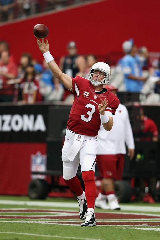Description of . Quarterback Carson Palmer #3 of the Arizona Cardinals drops back to pass prior to the start of the game against the Detroit Lions at University of Phoenix Stadium on September 15, 2013 in Glendale, Arizona.  (Photo by Jeff Gross/Getty Images)