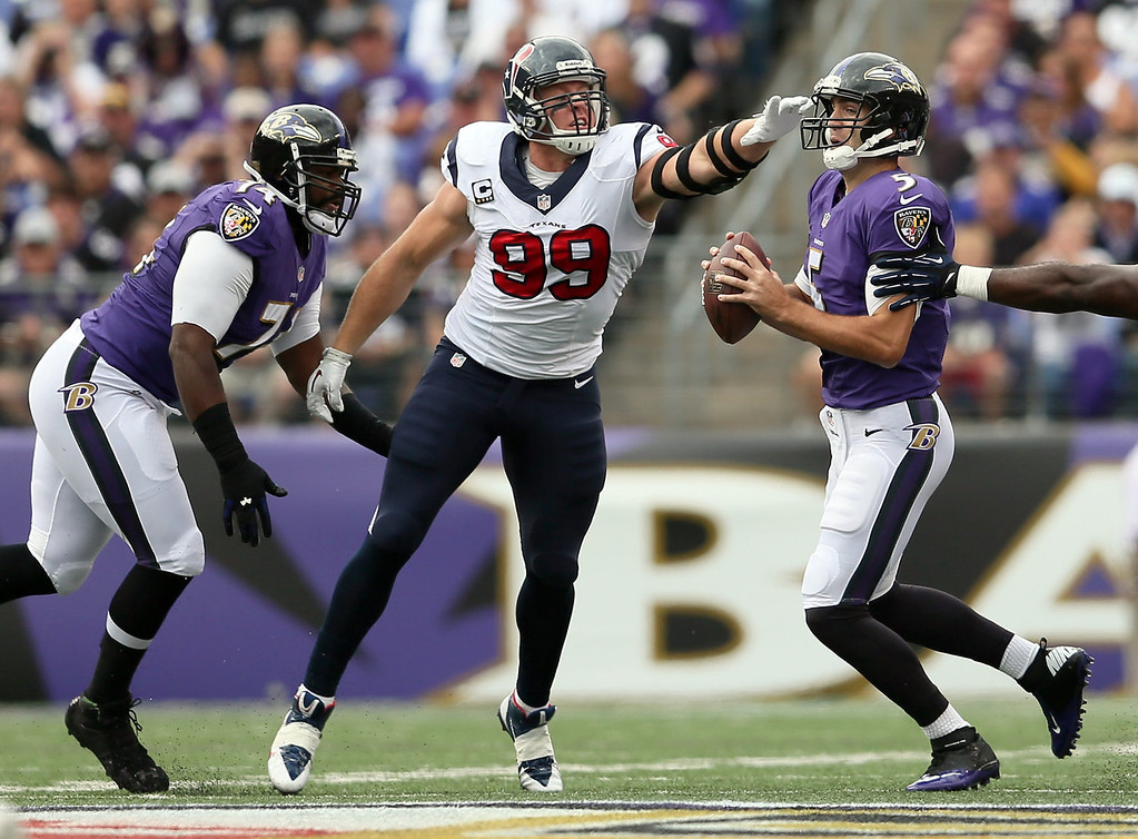Description of . Defensive end J.J. Watt #99 of the Houston Texans pressures quarterback Joe Flacco #5 of the Baltimore Ravens during the first half at M&T Bank Stadium on September 22, 2013 in Baltimore, Maryland.  (Photo by Rob Carr/Getty Images)
