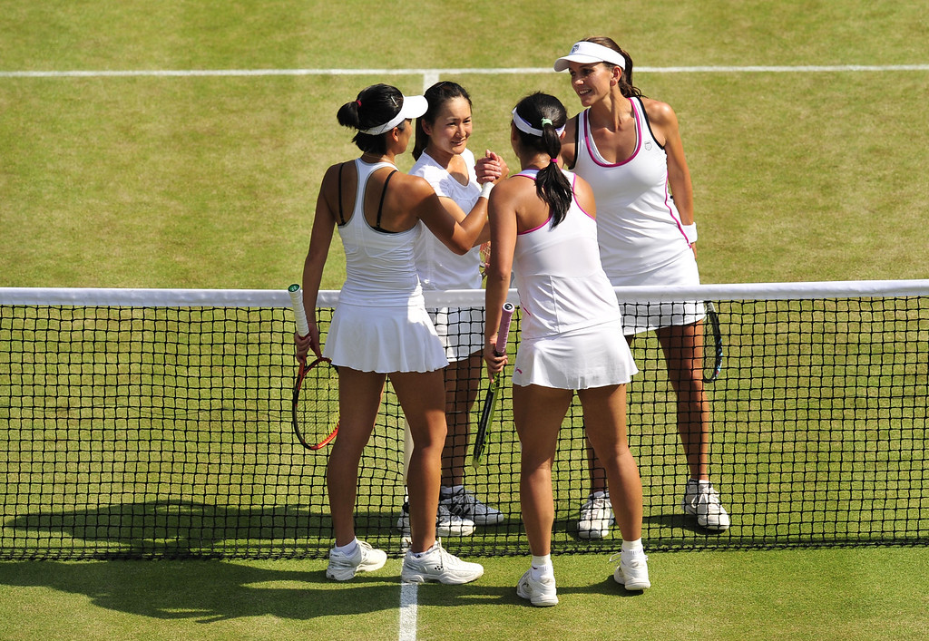 Description of . Japan\'s Shuko Aoyama (2nd L) and South Africa\'s Chanelle Scheepers (R) congratulate China\'s Peng Shuai and Taiwan\'s Hsieh Su-Wei after they won their ladies doubles semi-final match on day eleven of the 2013 Wimbledon Championships tennis tournament at the All England Club in Wimbledon, southwest London, on July 5, 2013. GLYN KIRK/AFP/Getty Images