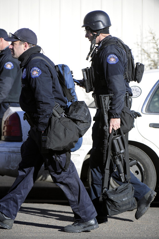 Description of . Police respond to the scene of a barricaded man, Saturday, Jan. 5, 2013 in Aurora, Colo. Four people, including an armed suspect, died during an hours-long police standoff Saturday at a Colorado townhome, authorities said. (AP Photo/The Denver Post, Andy Cross)