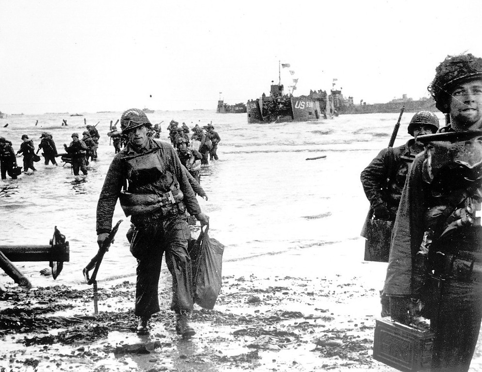 Description of . Carrying full equipment, American assault troops move onto a beachhead code-named Omaha Beach, on the northern coast of France, in this June 6, 1944 file photo, during the Allied invasion of the Normandy coast. (AP Photo)