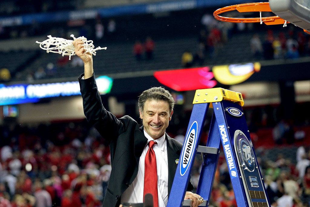 Description of . Head coach Rick Pitino of the Louisville Cardinals celebrates with the net after they won 82-76 against the Michigan Wolverines during the 2013 NCAA Men\'s Final Four Championship at the Georgia Dome on April 8, 2013 in Atlanta, Georgia.  (Photo by Streeter Lecka/Getty Images)