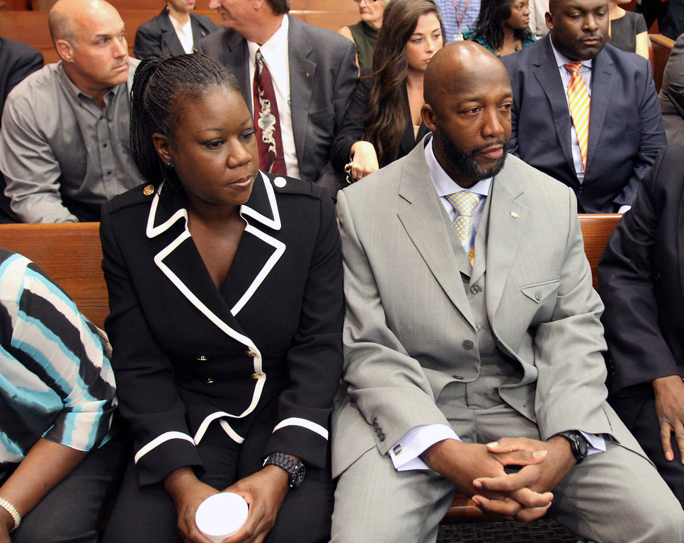 ". The parents of Trayvon Martin, Sybrina Fulton, left, and Tracy Martin, sit in the courtroom, Friday, April 20, 2012, during a bond hearing for George Zimmerman in Sanford, Fla.  Circuit Judge Kenneth Lester says Zimmerman can be released on $150,000 bail as he awaits trial for the shooting death of Trayvon Martin. Zimmerman is charged with second-degree murder in the shooting of Martin. He claims self-defense. ""Trayvon Martin shooting\"" ranked as Google\'s ninth most searched trending event of 2012. (AP Photo/Orlando Sentinel, Gary W. Green, Pool)"