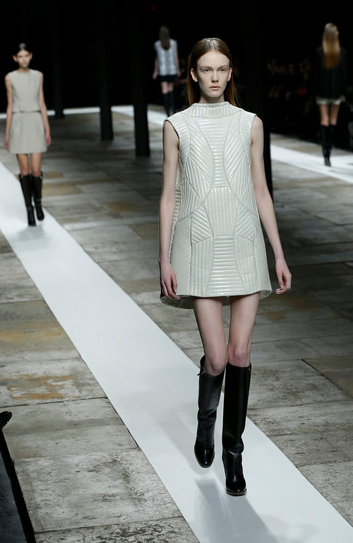 Description of . Models walk the runway during the Theyskens Theory Fall 2013 runway show at Fashion Week in New York, Monday, Feb. 11, 2013.  (AP Photo/Kathy Willens)