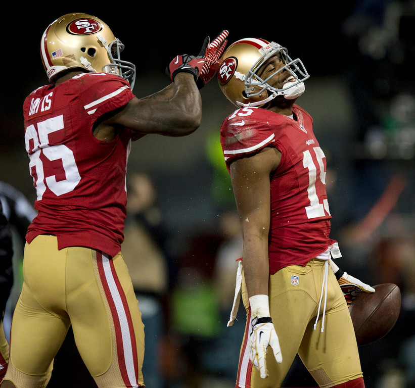 Description of . San Francisco 49ers tight end Vernon Davis (85) celebrates with wide receiver Michael Crabtree (15) after his touchdown in the second quarter during an NFC divisional playoff NFL football game against the Green Bay Packers on Saturday, Jan. 12, 2013, in San Francisco. (AP Photo/The Sacramento Bee, Paul Kitagaki Jr.)