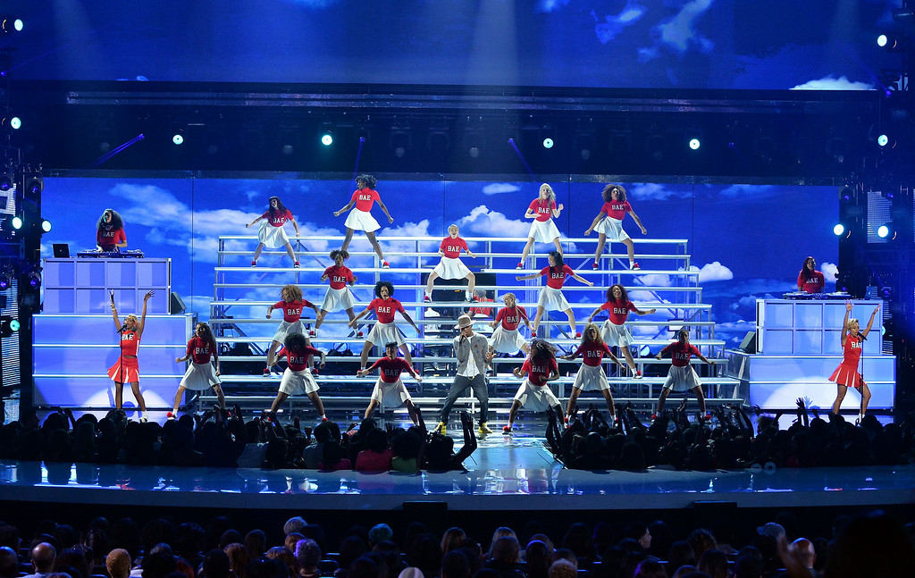 Description of . Singer Pharrell Williams performs onstage during the BET AWARDS '14 at Nokia Theatre L.A. LIVE on June 29, 2014 in Los Angeles, California.  (Photo by Kevin Winter/Getty Images for BET)