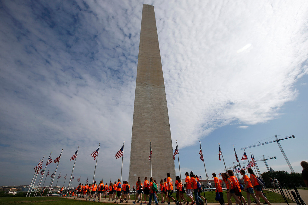 . Students from Bridge Street Middle School in Wheeling, W.Va., walk at the Washington Monument in Washington, Monday, May 12, 2014, ahead of a ceremony to celebrate its re-opening.  (AP Photo)
