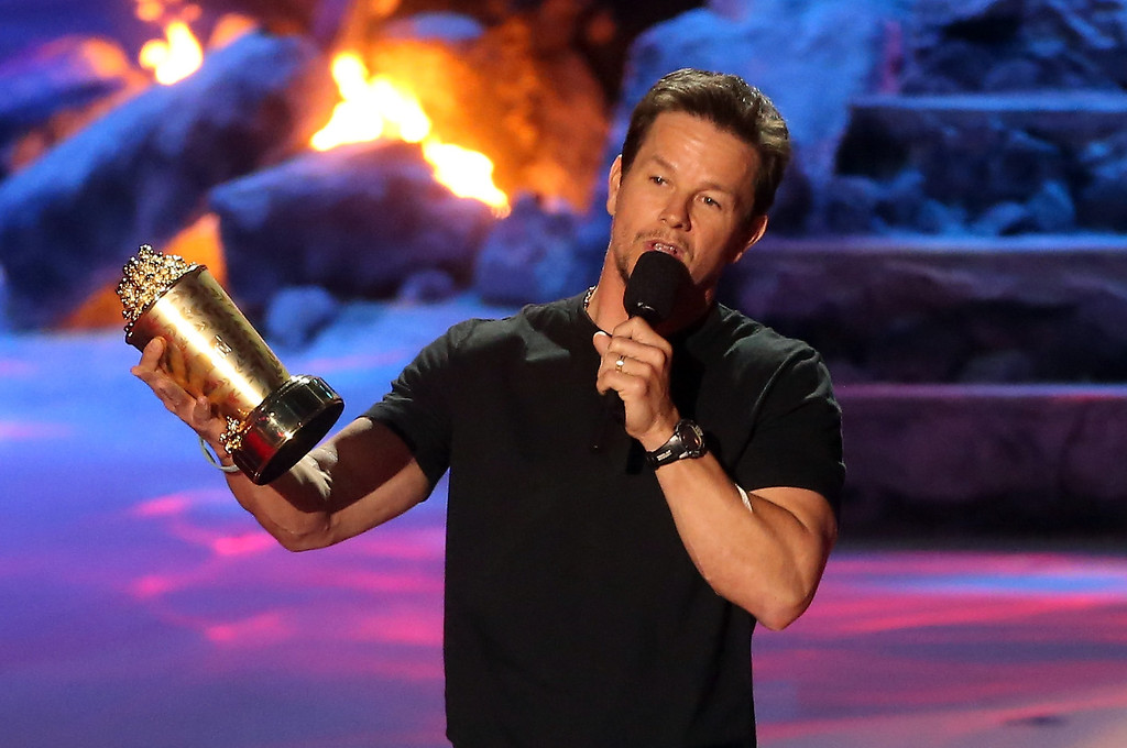 Description of . Actor Mark Wahlberg accepts the MTV Generation Award onstage at the 2014 MTV Movie Awards at Nokia Theatre L.A. Live on April 13, 2014 in Los Angeles, California.  (Photo by Frederick M. Brown/Getty Images)