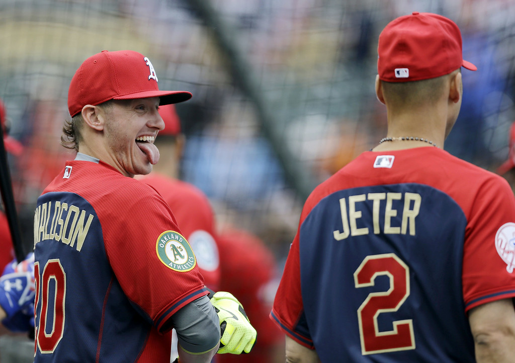 Description of . American League third baseman Josh Donaldson, left, of the Oakland Athletics, jokes with short stop Derek Jeter, of the New York Yankees, during batting practice for the MLB All-Star baseball game, Monday, July 14, 2014, in Minneapolis. (AP Photo/Jeff Roberson)