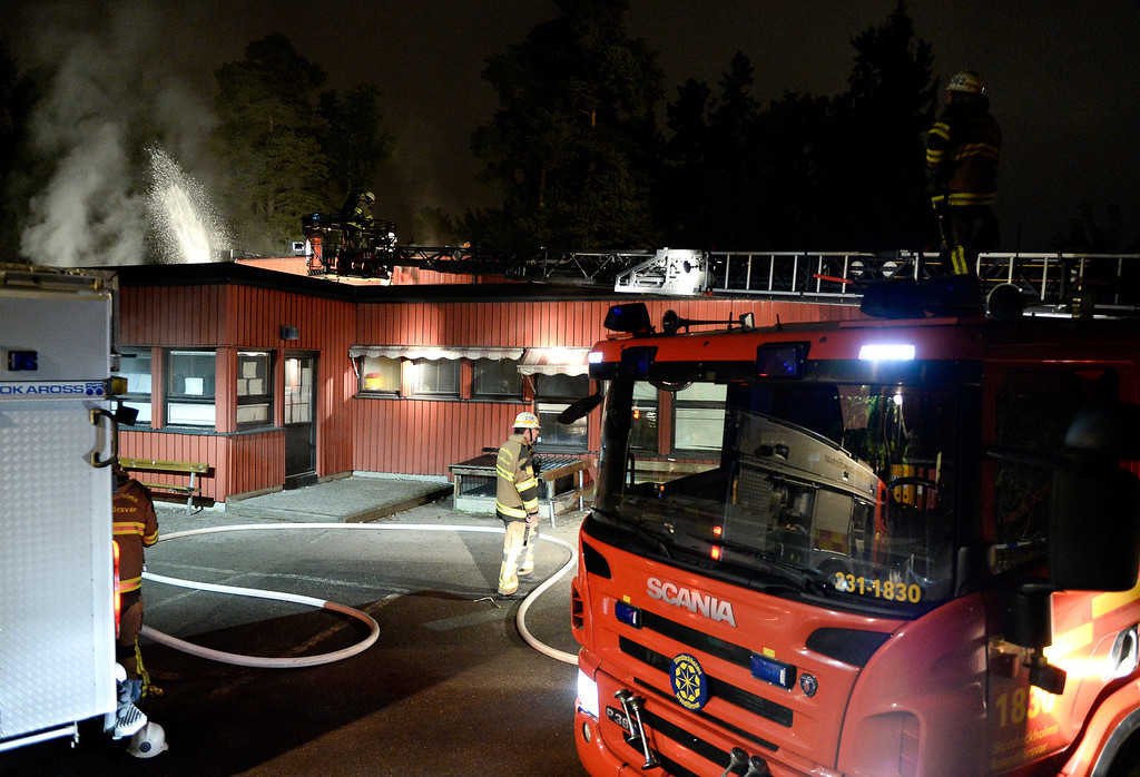 Description of . Firemen extinguish a blaze at a nursery school in the Stockholm suburb of Kista after youths rioted in several different suburbs around Stockholm, Sweden for a fourth consecutive night on May 24, 2013. In the suburb of Husby, where the riots began on Sunday in response to the fatal police shooting of a 69-year-old machete-wielding man, 80 percent of residents are immigrants and the unrest has highlighted Sweden's failure to integrate swathes of its immigrant population, but in this small, consensus-driven country, there was little agreement on how to solve the problem. JONATHAN NACKSTRAND/AFP/Getty Images