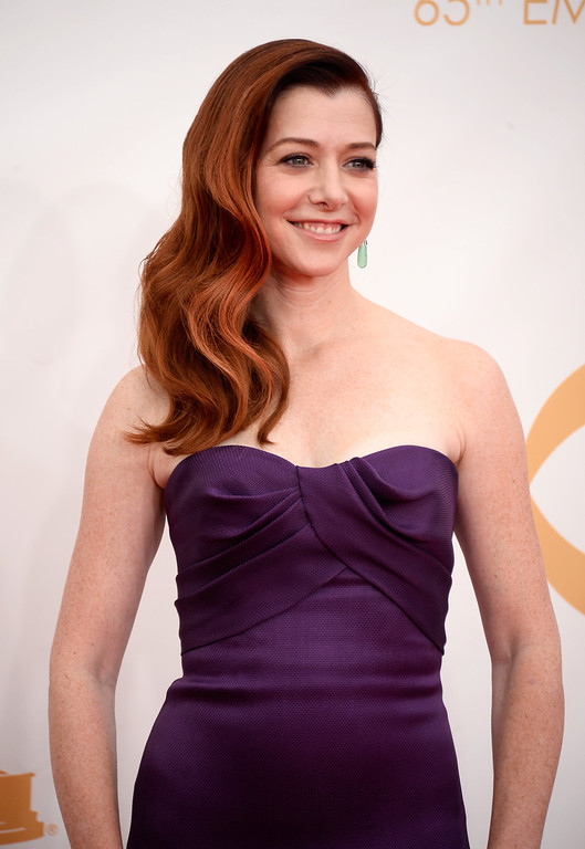 Description of . Actress Alyson Hannigan arrives at the 65th Annual Primetime Emmy Awards held at Nokia Theatre L.A. Live on September 22, 2013 in Los Angeles, California.  (Photo by Frazer Harrison/Getty Images)