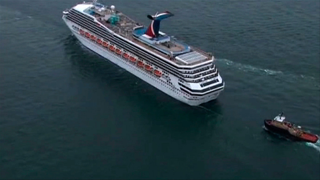Description of . The cruise ship Carnival Triumph cruise ship is towed in this video frame grab from NBC REUTERS/NBC News/Handout