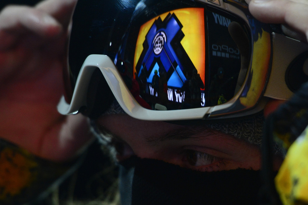 Description of . ASPEN, CO - JANUARY 27: Greg Bretz adjusts his goggles during the men's snowboard superpipe final. X Games Aspen Buttermilk Mountain January 27, 2013. (Photo By AAron Ontiveroz/The Denver Post)