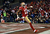 Wide receiver Michael Crabtree #15 of the San Francisco 49ers runs the ball in for a touchdown thrown by quarterback Colin Kaepernick #7 in the second quarter against the Green Bay Packers during the NFC Divisional Playoff Game at Candlestick Park on January 12, 2013 in San Francisco, California.  (Photo by Harry How/Getty Images)