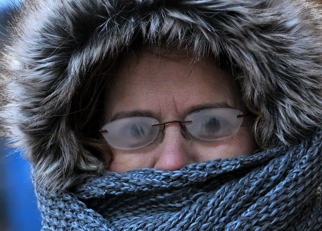 Description of . With  temperatures below zero, Brenda Williams, 53, of Charleston, braves the cold to get her haircut downtown Charleston, W.Va..  Her glasses had frosted over and she could barely see.     (AP Photo/The Daily Mail, Craig Cunningham)