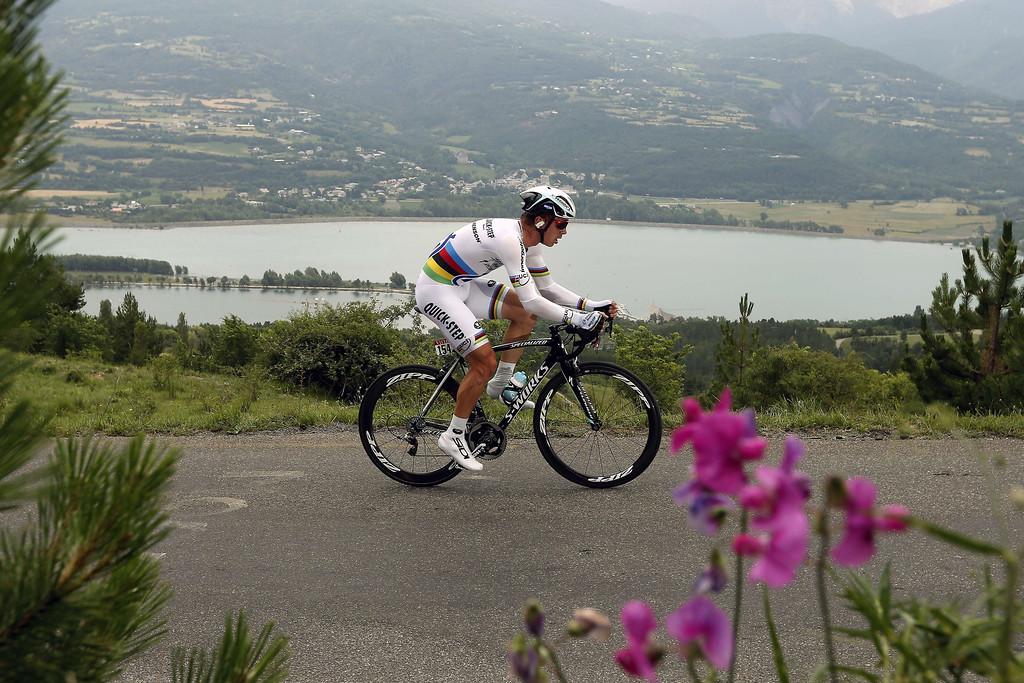 Description of . Germany's Tony Martin rides during the 32 km individual time-trial and seventeenth stage of the 100th edition of the Tour de France cycling race on July 17, 2013 between Embrun and Chorges, southeastern France.  AFP PHOTO / JOEL SAGETJOEL SAGET/AFP/Getty Images