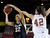 University of Colorado's Arielle Roberson takes a shot over Alison Janecek during a games against the University of Denver on Tuesday, Dec. 11, at the Magnus Arena on the DU campus in Denver.   (Jeremy Papasso/Daily Camera)