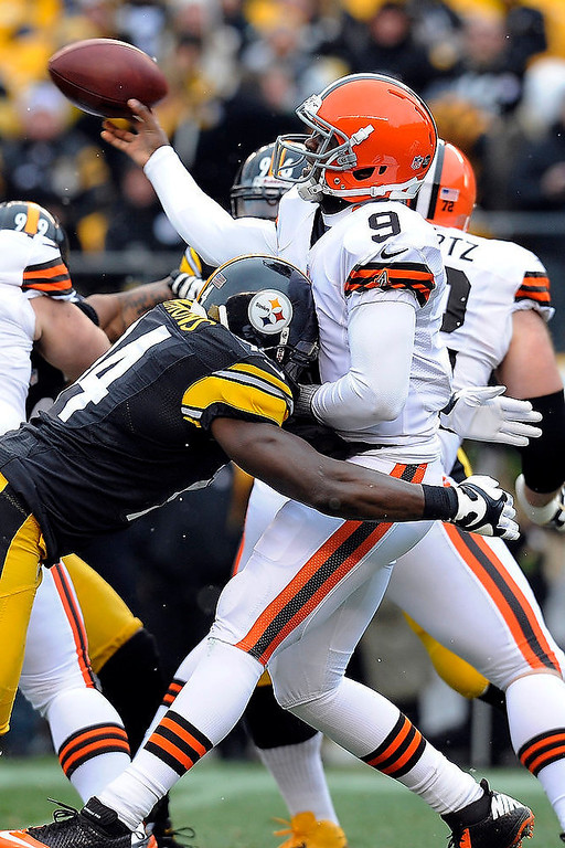 Description of . Pittsburgh Steelers inside linebacker Lawrence Timmons (94) hits Cleveland Browns quarterback Thad Lewis as Lewis passes in the first quarter an NFL football game on Sunday, Dec. 30, 2012, in Pittsburgh. (AP Photo/Don Wright)
