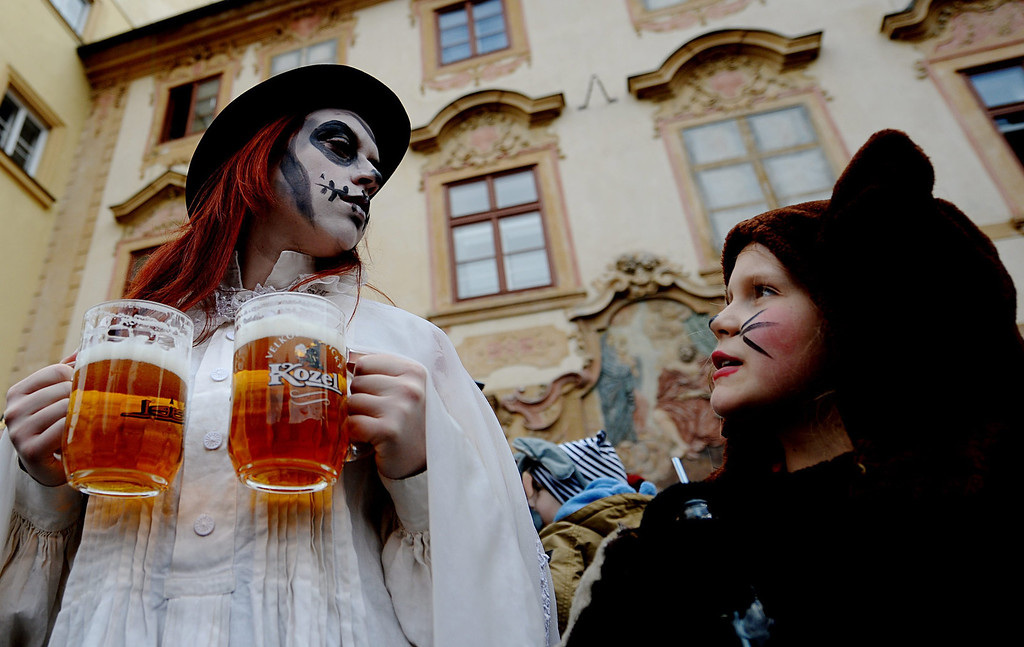 Description of . A carnival goer holding two beers stands in the streets after the Malostranky carnival parade in Prague, Czech Republic, 01 March 2014. \'Masopust\' meaning carnival in Czech is considered the last opportunity to celebrate and eat rich food before the start of the 40-day Lent period.  EPA/FILIP SINGER