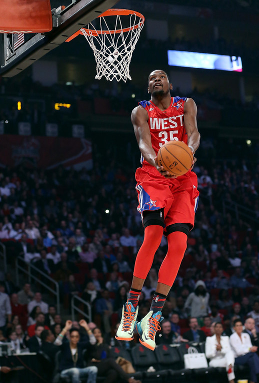 Description of . HOUSTON, TX - FEBRUARY 17:  Kevin Durant #35 of the Oklahoma City Thunder and the Western Conference goes up for a reverse dunk in the first quarter during the 2013 NBA All-Star game at the Toyota Center on February 17, 2013 in Houston, Texas. (Photo by Ronald Martinez/Getty Images)