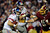 LANDOVER, MD - DECEMBER 03:  Eli Manning #10 of the New York Giants is sacked by the Washington Redskins during the second half of game at FedExField on December 3, 2012 in Landover, Maryland.  (Photo by Patrick McDermott/Getty Images)