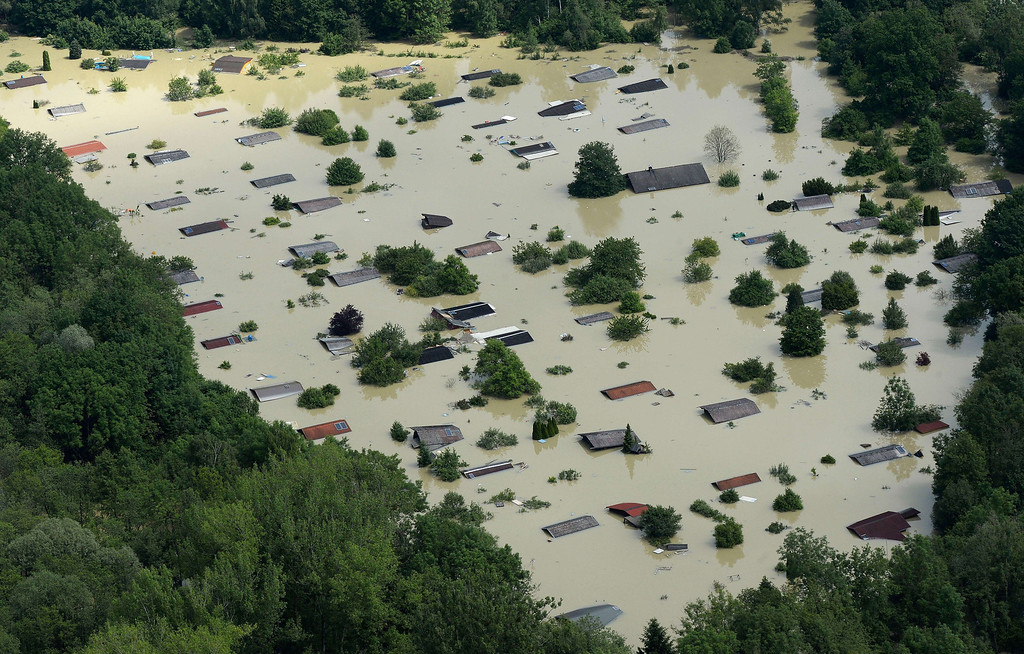 Description of . An aerial view shows summer houses flooded by water from the River Danube near the Bavarian village Deggendorf, southern Germany, on June 6, 2013. Germany pushed on with frantic efforts to secure saturated river dykes with sandbags, bracing for a surge of the worst floods in over a decade.   CHRISTOF STACHE/AFP/Getty Images
