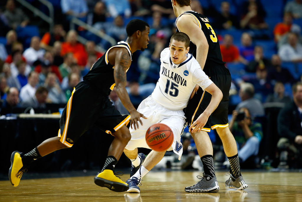 Description of . BUFFALO, NY - MARCH 20: Ryan Arcidiacono #15 of the Villanova Wildcats defends against Jordan Aaron #1 of the Milwaukee Panthers during the second round of the 2014 NCAA Men's Basketball Tournament at the First Niagara Center on March 20, 2014 in Buffalo, New York.  (Photo by Jared Wickerham/Getty Images)