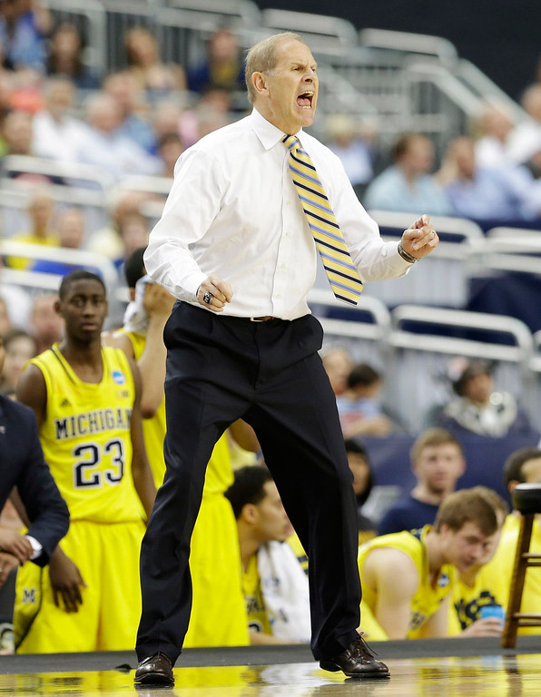 Description of . Michigan head coach John Beilein reacts against Michigan during the first half of a regional final game in the NCAA college basketball tournament, Sunday, March 31, 2013, in Arlington, Texas. (AP Photo/David J. Phillip)