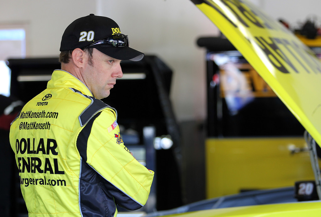 . DAYTONA BEACH, FL - FEBRUARY 20:  Matt Kenseth, driver of the #20 Dollar General Toyota, stands in the garage during practice for the NASCAR Sprint Cup Series Daytona 500 at Daytona International Speedway on February 20, 2013 in Daytona Beach, Florida.  (Photo by Todd Warshaw/Getty Images)