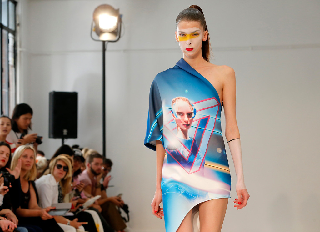 Description of . A model presents a creation by fashion designers Eri and Philip Chu, from Hong Kong, for Ground Zero's ready-to-wear Spring/Summer 2014 fashion collection, presented in Paris, Tuesday, Sept.24, 2013. (AP Photo/Jacques Brinon)