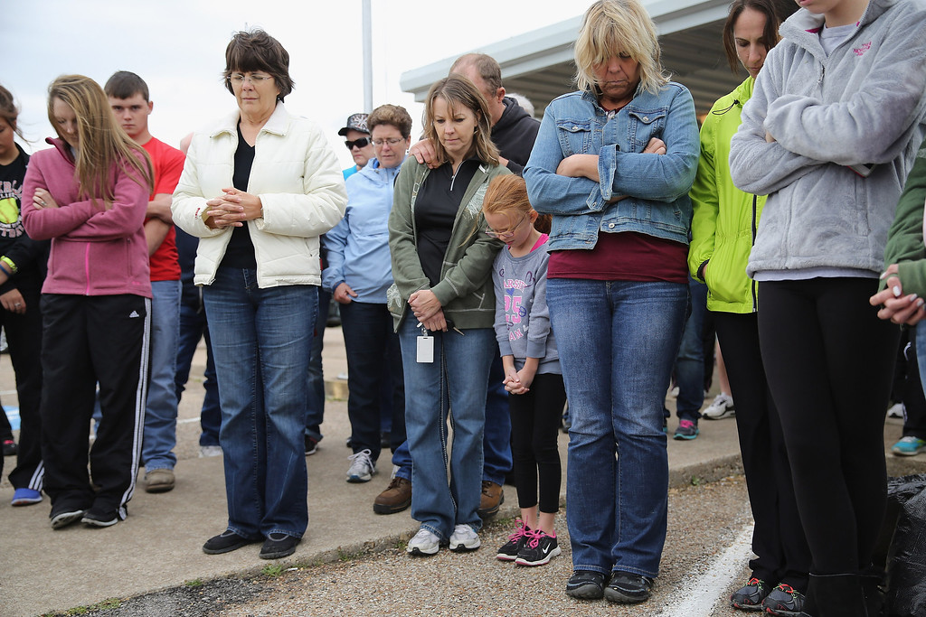 Description of . WEST, TX - APRIL 18:  Residents gather outside the West Community Center to pray for the victims and survivors the day after the West Fertilizer Company explosion April 18, 2013 in West, Texas. The fertilizer company caught fire and exploded, killing more than five people, injuring more than 160 people and leaving damaged buildings for blocks in every direction.  (Photo by Chip Somodevilla/Getty Images)