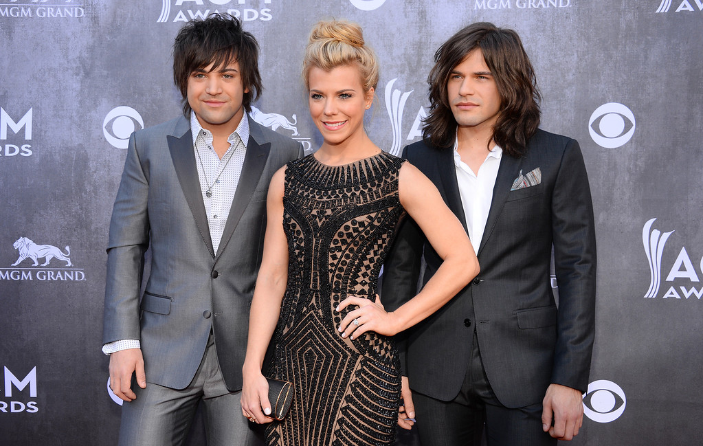Description of . Neil Perry, and from left, Kimberly Perry and Reid Perry, of the musical group The Band Perry, arrive at the 49th annual Academy of Country Music Awards at the MGM Grand Garden Arena on Sunday, April 6, 2014, in Las Vegas. (Photo by Al Powers/Powers Imagery/Invision/AP)