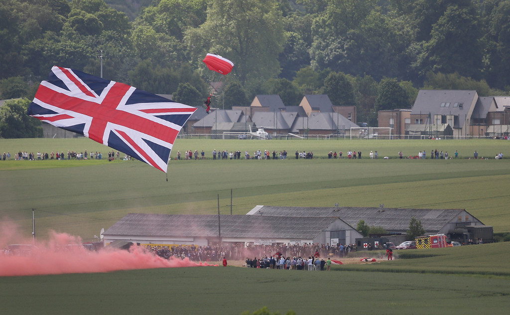 Description of . The British Army Red Devils parachute display team appear on June 5, 2014 near Ranville, France.   (Photo by Peter Macdiarmid/Getty Images)