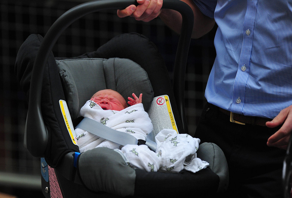 Description of . Prince William and Catherine, Duchess of Cambridge\'s new-born baby boy is introduced to the world\'s media outside the Lindo Wing of St Mary\'s Hospital in London on July 23, 2013. The baby was born on Monday afternoon weighing eight pounds six ounces (3.8 kilogrammes). The baby, titled His Royal Highness, Prince (name) of Cambridge, is directly in line to inherit the throne after Charles, Queen Elizabeth II\'s eldest son and heir, and his eldest son William.   CARL COURT/AFP/Getty Images