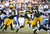 Aaron Rodgers #12 of the Green Bay Packers scrambles out of the pocket as Kamerion Wimbley #95 of the Tennessee Titans grabs his jersey at Lambeau Field on December 23, 2012 in Green Bay, Wisconsin.  (Photo by Tom Lynn /Getty Images)