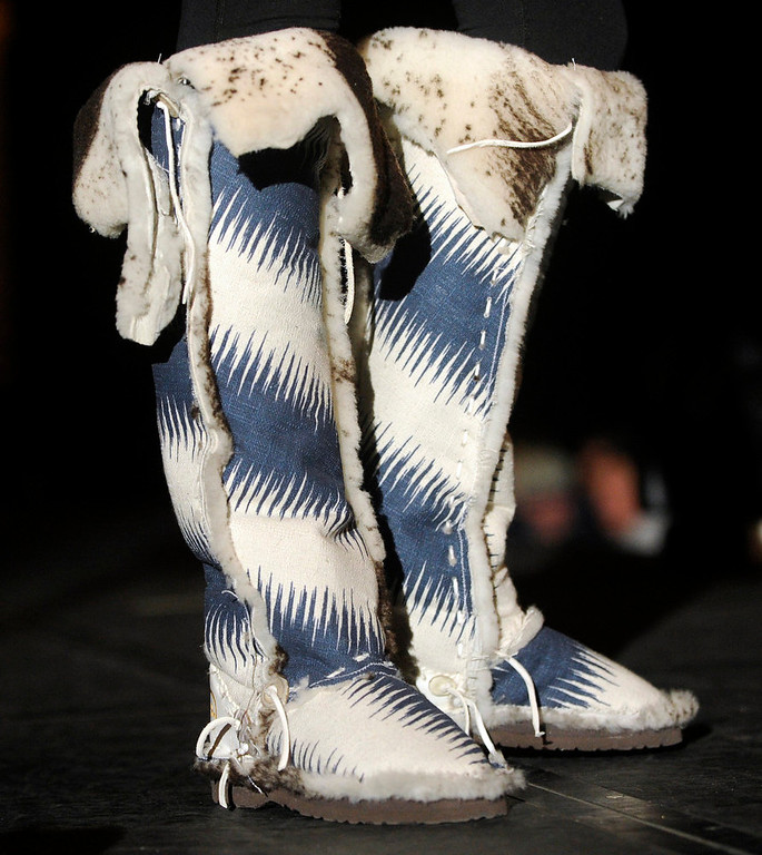 Description of . Lots of Malibu  boots, as the SIA Snow Show hosted its 2013 Snow Fashion & Trends Show at the Colorado Convention Center  in downtown Denver  on Wednesday, January 30, 2013.  (Photo By Cyrus McCrimmon / The Denver Post)
