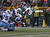 James Jones #89 of the Green Bay Packers reaches over the goal line to score as he is hit by Jarius Wynn #79, Zach Brown #55 and Alterraun Verner #20 of the Tennessee Titans at Lambeau Field on December 23, 2012 in Green Bay, Wisconsin. The Packers defeated the Titans 55-7. (Photo by Jonathan Daniel/Getty Images)